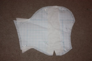 Sleeve pieces. I cut vertically down the highest part of the sleeve head and widened the sleeve to fit my shoulders. I then needed to take the sleeve in around the arms later.