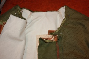 The collar is pinned ready to sew. Note how the piping from the collar and the centre front are positioned to create a continuous look.