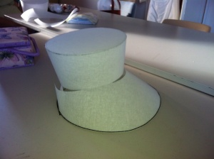 The buckram top and brim, partially assembled