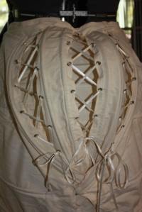 The 'cage' of the bustle, laced together with ribbon.