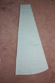 The front panel of the fan skirt, centre front on the fold.
