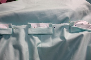"The waistband is in two parts; the normal waistband is cut to reach almost all the way around to the back but there is a second waistband ""tab"" in the centre back which the sides attach to."