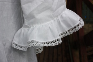The sleeve ruffle attached. Very pretty, I think!