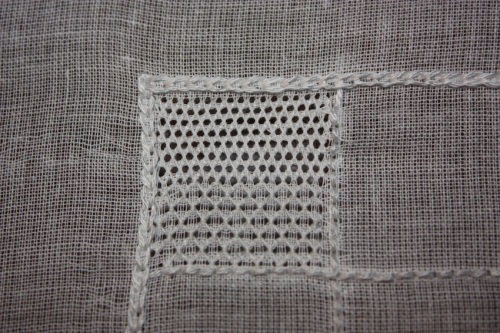 The top half is in wave stitch, and the bottom half is in honeycomb stitch.