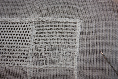The top half is in spaced satin stitch. The bottom half is in stepped satin stitch and basketweave stitch.