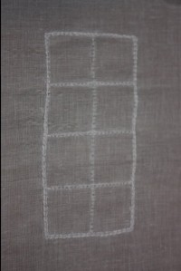 Chain stitch around the outside and backstitch on the inside grid.