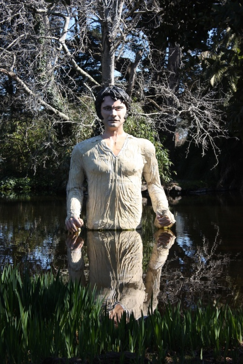Mr Darcy's statue that recreates the scene in Pride and Prejudice (2005) where Colin Firth as Mr Darcy swims in his lake at Pemberley.