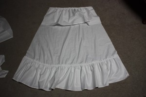 The bottom frill is attached along the bottom of the back panel.