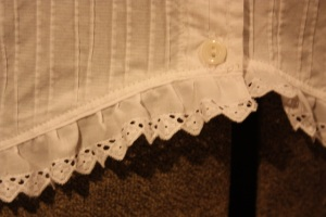 The lace sewn to the bottom edge.