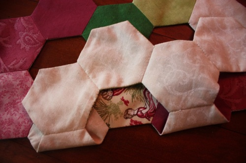 The underside of my table runner, showing the lining hexagons.