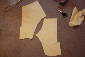 The breeches back and front marked with pins and cut out.
