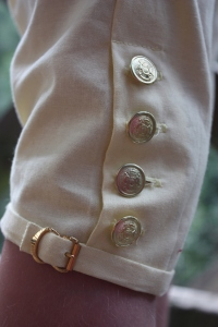 The knee buttons and buckle. The buttons are