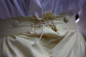 The back triangular gusset in the centre back, laced with cotton cording.