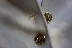 The buttons and handsewn buttonholes