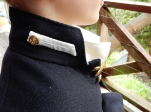 The midshipman badge on the collar.