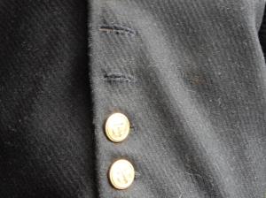 The buttonholes are handsewn with buttonhole stitch.