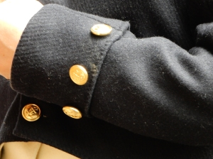 The cuffs, with the non-functional buttons sewn on through the sleeve to hold the cuff in place.