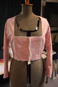 The bodice with sleeves attached.