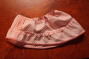 The inside of the double elbow flounce, showing the hand stitching.
