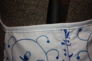 The top edge of the pocket bound.