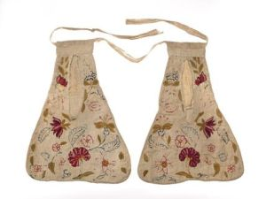 A pair of cotton and linen pockets, embroidered with wool, from the Museum of London.