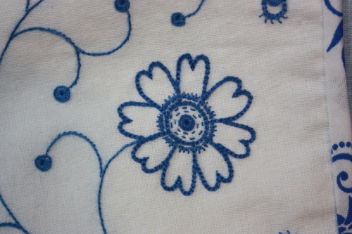 This flower has ben embroidered with chain stitch, long and short stitch, ...