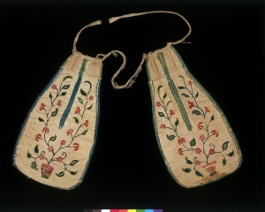 A pair of linen pockets, embroidered with wool, from the Victoria and Albert Museum.