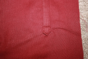 The reinforcing stitching at the bottom of the fall front.