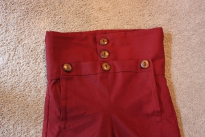 The buttons on the fall front.