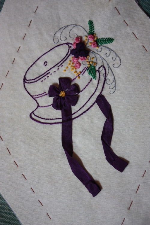 A purple bonnet embroidery