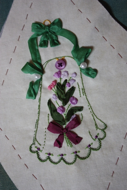A green reticule embroidery