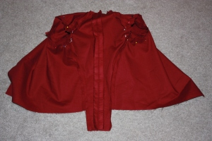 The centre back and side seams have been sewn, and the sleeves are pinned ready to sew.