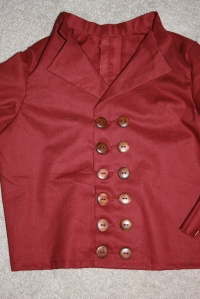 The buttons and buttonholes sewn.