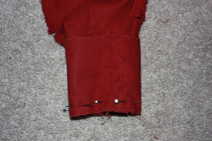 The cuff is sewn to the sleeve.