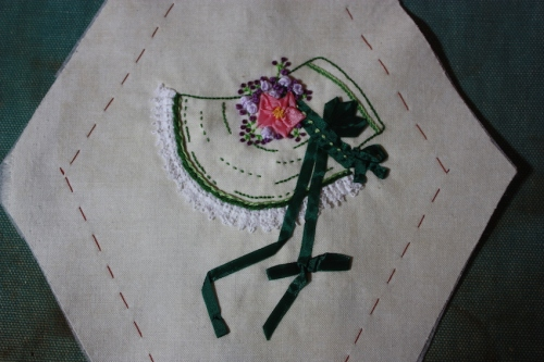 A dark green bonnet embroidery