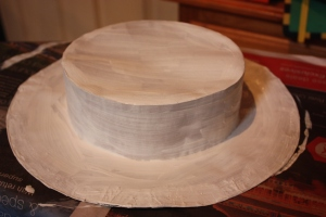 The hat is painted with gesso.