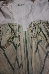 The tapes sewn to the inside of the skirts, and tied up to form a polonaise.