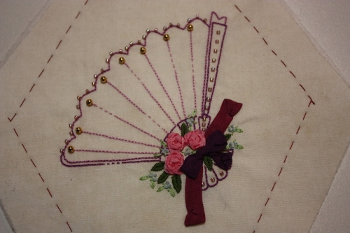 A floral fan in purple accents