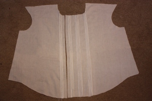 The front panel, with rows of pin tucks.