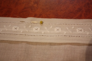 The insertion lace pinned down to sew.