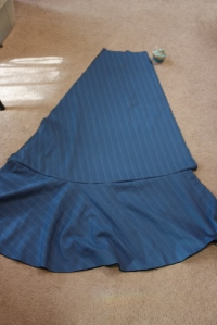 The circular flounce is sewn to the side panel.