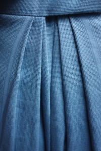 The back pleats of the skirt