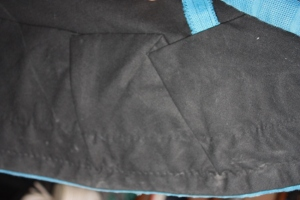 The inside of the hem, showing the folded facing stitched down.