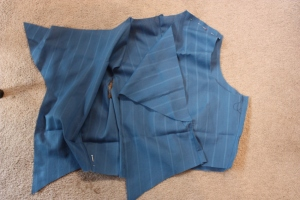 The outer layer of the jacket is sewn together, except for the shoulder seams.