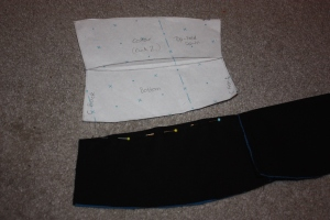 The top edge of the collar is pinned right sides together to sew.