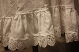 The lace was first attached to the ruffle strip, which was then gathered and sewn to the bottom of the leg.