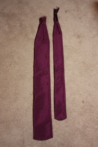 The two sashes, with a box pleat at the top.
