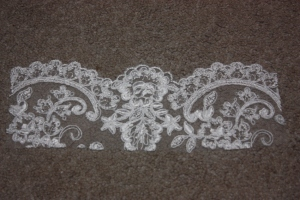 Lace was cut to fit in the front and back neckline.