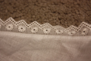 The lace finishing the armhole.