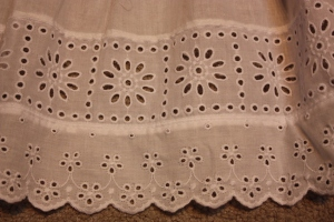 The bottom of the frill is edged with a row of insertion lace and a row of broider anglaise.
